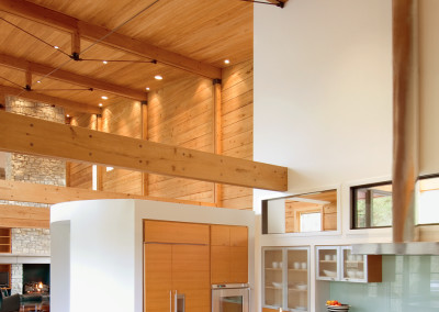 "Interior view of cypress log home with cypress walls, ceiling, beams, and cabinetry.<br/> <span class=""gallery-courtesy"">Courtesy Craig Thompson</span>"